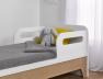 Lit bébé évolutif combiné Calisson blanc et bois en position petit lit enfant.