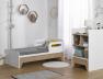 Lit bébé évolutif combiné Calisson en position petit lit enfant avec sa table à langer
