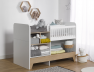 Lit bébé évolutif combiné Calisson blanc et bois avec sa table à langer amovible.